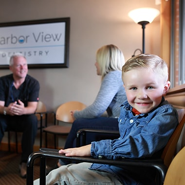 A little boy, who is an actual patient at Harbor View Dentistry, smiling at the camera