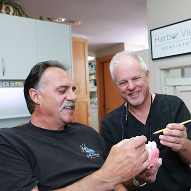 Dr. Aichlmayr talking about dental implants with a patient