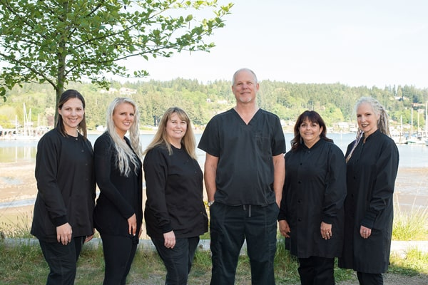 Dr. Jim Aichlmayr who is a family dentist in Gig Harbor with his friendly team overlooking the Puget Sound
